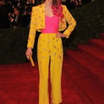 "Coco Rocha Wearing a Givenchy pantsuit, Sergio Rossi pink ""Milady"" pumps, and a bag by Kotur"